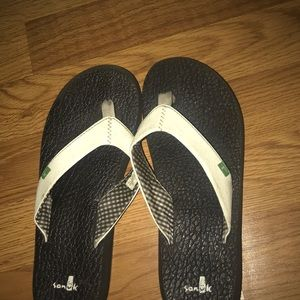 Black and White , Sanuks flipflops  size 7